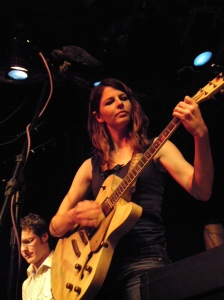 Lara Ruggles (with Justin Roth in the background) at Avogadro's Number, Fort Collins